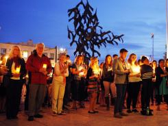 Boston University students and faculty members hold a candlelight vigil on Marsh Plaza at Boston University on Saturday.