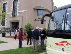 More than 40 members of the Portage, Mo., Senior Center get off a tour bus May 2 outside the historic Jackson State Prison.