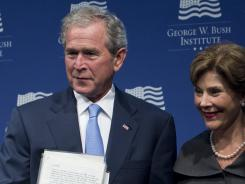 Former President George W. Bush and wife Laura Bush will appear at the White House for the release of their portraits.