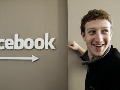 Facebook CEO Mark Zuckerberg smiles in this office in Palo Alto, Calif. Zuckerberg turned 28 on Monday.