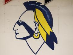 The Banks High School mascot is shown on the wall of their gym Thursday in Banks, Ore.