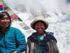 Tamae Watanabe, right, poses with photograher Noriyuki Muraguchi at a base camp on the foot of Mt. Everest in Nepal.