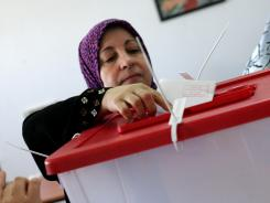 A Libyan resident in the eastern city of Benghazi casts her ballot at a polling station Saturday.