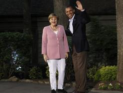 President Obama greets German Chancellor Angela Merkel on arrival for the G8 Summit Friday at Camp David, Md.