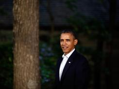 President Obama waits to greet G8 leaders on Friday in front of Laurel Lodge during the 2012 G8 in Camp David, Md.