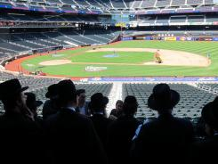 A group of Ultra-Orthodox Jews check out the facilities at New York's Citi Field on April 3.