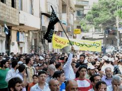 Syrians chant slogans during a demonstration in Damascus.
