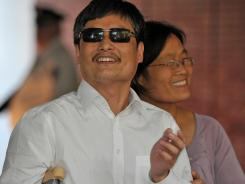 In Manhattan: Chen Guangcheng and wife Yuan Weijing on Saturday.