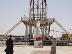 Oil workers are seen at West Qurna Phase 2, one of Iraq's biggest and most promising oil fields, near Basra in April.