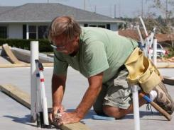 Richard King, a retired plumber, rebuilds his home in Joplin, Mo.