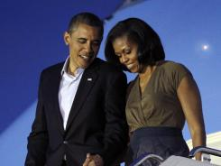 President Obama and first lady Michelle arrive at Chicago O'Hare International airport on Saturday for the NATO summit.