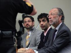 Dharun Ravi, center, listens to a court officer with his attorneys Philip Nettl, left, and Steve Altman during his sentencing in New Brunswick, N.J., on Monday.