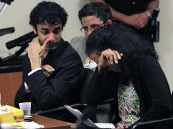 Dharun Ravi, left, looks on as his mother, Sabitha Ravi, cries as she reads a statement Monday in New Brunswick, N.J.