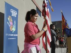 Aileen Romero, 11, carries the American flag during a morning assembly at Pena Blanca Elementary School in Rio Rico, Ariz., 12 miles north of the Mexican border. The Census continued to miss blacks and Hispanics in 2010, a Census analysis shows.