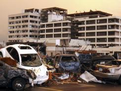 Tornado damage: Destroyed vehicles are piled in the parking lot of the Joplin Regional Medical Center in Joplin, Mo., last May.