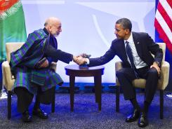 President Obama meets with Afghanistan President Hamid Karzai at the NATO summit in Chicago on Sunday.
