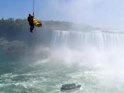 Emergency officials rescue a man who plunged over Niagara Falls on Monday, surviving an apparent suicide attempt.