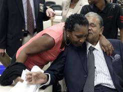 Elaine Riddick, who was sterilized in North Carolina as a teen, hugs Rep. Larry Womble, D-Forsyth, after a House committee meeting Tuesday in Raleigh, N.C.