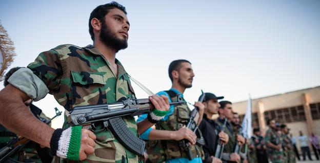 New recruits participate in a parade as they join the ranks of the Free Syrian Army in Qusayr on May 8.