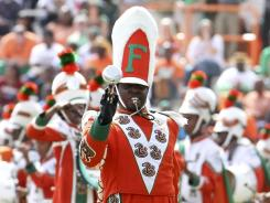 Florida A&M Drum Major Robert Champion performs during halftime of a football game in 2011. Prosecutors in Orlando are releasing thousands of documents in Champion's hazing death.