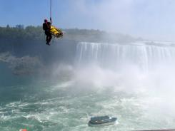 Niagara Falls emergency officials rescue a man who plunged over Niagara Falls and survived in an apparent suicide attempt Monday. The man is only the third person known to have gone over without a safety device and lived.