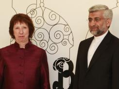 EU foreign policy chief Catherine Ashton poses with Saeed Jalili, Iran's chief nuclear negotiator, on Wednesday in Baghdad.