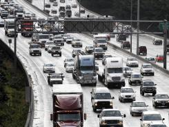 Heavy traffic is shown on north-bound Interstate Highway 5 in Seattle.