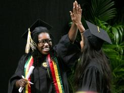 Georgia Tech graduate Rita Mucauele, left, of Gainesville, Fla., high-fives a fellow graduate after they received their diplomas during Spring 2012 Commencement at the Georgia Dome in Atlanta earlier this month.