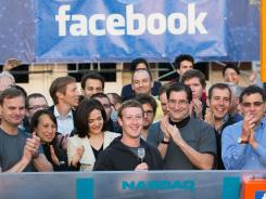 Menlo Park, Calif.: Mark Zuckerberg, center, rings the Nasdaq opening bell remotely May 18.