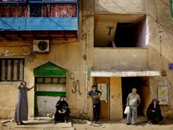 Egyptians wait to cast their votes Thursday in the El Hamara neighborhood of Cairo.