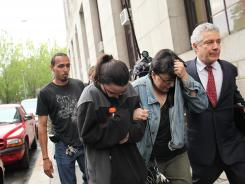 Family members of Pedro Hernandez, who was charged with Etan Patz's murder, walk away from a courthouse on Friday. Hernadez's daughter, Becky, left, and wife, Rosemary, are escorted by lawyers and a family friend.