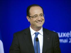 French President Francois Hollande speaks during a press conference after a meeting of European Union leaders in Brussels on Thursday.