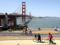 Tourists ride bicycles on a newly constructed bike path near the Golden Gate Bridge, whose 75th anniversary will be marked this weekend.