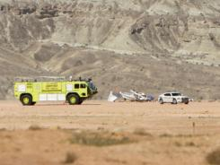 Emergency officials respond to a fatal plane crash near the St. George Municipal Airport on Saturday.