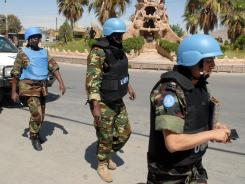 U.N. observers visit the outskirts of Damascus on Saturday.