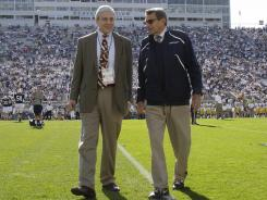 Penn State President Graham Spanier, left, and football coach Joe Paterno visit before a football game last October, just weeks before both were forced from their jobs.