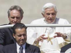 In this photo taken Wednesday, Pope Benedict XVI, flanked by his private secretary Georg Gaenswein, top left, and his butler, Paolo Gabriele, arrives at St. Peter's Square in Vatican City.
