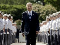 Vice President Biden makes his way down a row of cadets as he arrives to address graduates of the United States Military Academy at West Point on Saturday in West Point, N.Y.