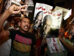 Supporters of Egyptian presidential candidate Hamdeen Sabahi shout slogans Saturday at his campaign headquarters in Cairo.