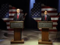 Republican Wisconsin Gov. Scott Walker, right, and Democratic challenger Tom Barrett get ready to participate in a televised debate on Friday in Milwaukee.
