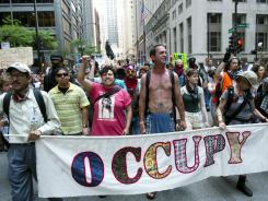 Occupy Wall Street protesters march through downtown Chicago on May 19.