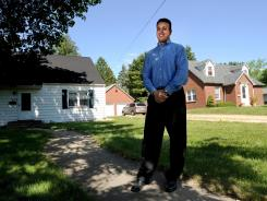Mohammed Labadi, a board member for the Islamic Society of Northern Illinois University, stands outside the house that serves as a mosque in DeKalb. The group plans to build a new mosque on neighboring land.