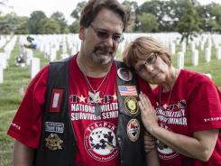 Kim and Angela Barbret share a moment at Arlington National Cemetery. Their son, Mark, was killed in Iraq October 2004.