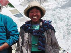 Tamae Watanabe of Japan poses at a base camp at the foot of Mount Everest in 2002. Earlier this month she smashed her own record.