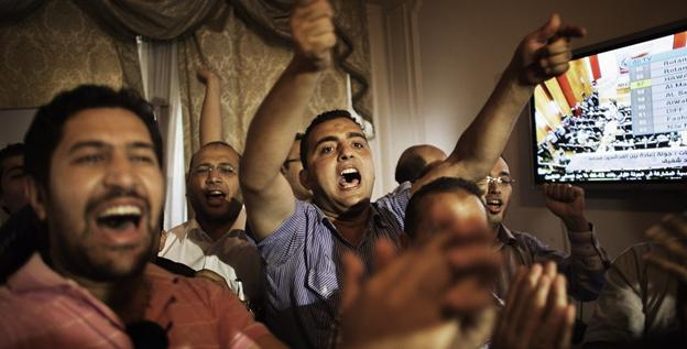 Supporters and campaign managers of Egyptian presidential candidate Ahmed Shafiq celebrate after the official results for the first round were announced Monday in Cairo.