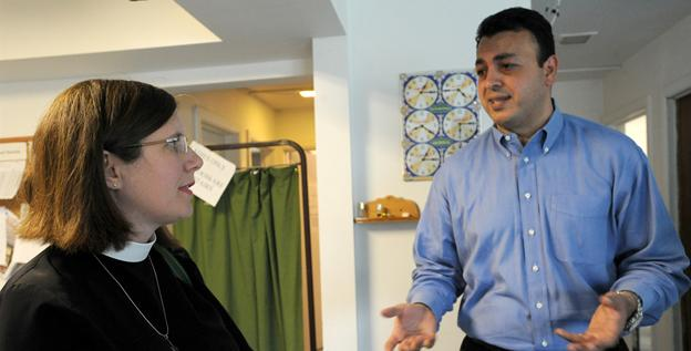 Rev. Stacy Walker-Frontjes, of St. Paul's Episcopal Church in DeKalb, Ill., talks with Mohammed Labadi as she tours the house that serves as the group's mosque.