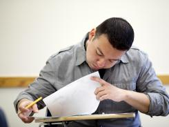 Vincent Acevedo, a Marine Corps veteran, takes a final exam for a Western Civilization class at Borough of Manhattan Community College in New York City.