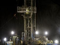A shale gas well operates at night in Moshannon State Forest in Clearfield County, Pa. Twenty states including Pennsylvania have shale gas wells, rigs that tap rock layers harboring gas in shale formations.