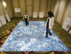 Major gathering: Carol Tebbs, of La Quinta, Calif., left, and Lamya Chaoui, of Chicago, walk a labyrinth Saturday at the United Astrology Conference.