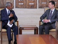 U.N. special envoy Kofi Annan, left, meets with Syrian President Bashar Assad Monday in Damascus, Syria.